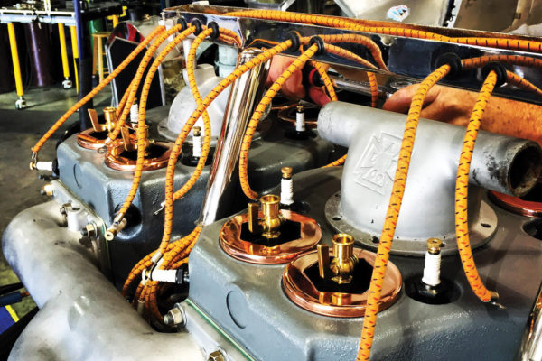 Here, you can see the cast upper water manifolds (these are the originals). Norwood created CAD models and had new castings made. Also evident are the copper valve caps with fuel priming cups and each cylinder has three spark plugs.