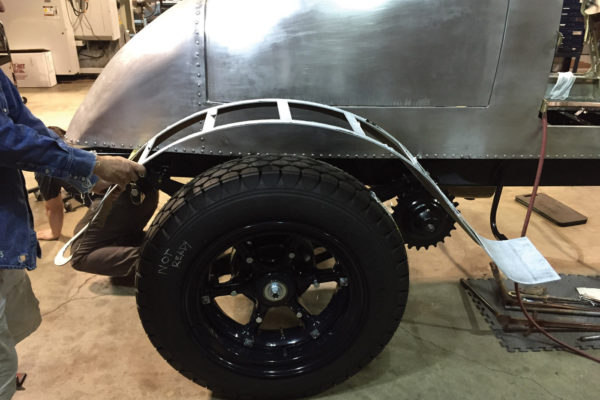 Here, Norwood technicians fit the inner fender framework. All of this framework was CAD drawn and waterjet cut for precision. The 40-inch-tall tires were custom made by Firestone to the original tread.