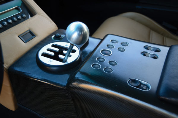 Original Lambo switchgear controls the Vintage Air system.