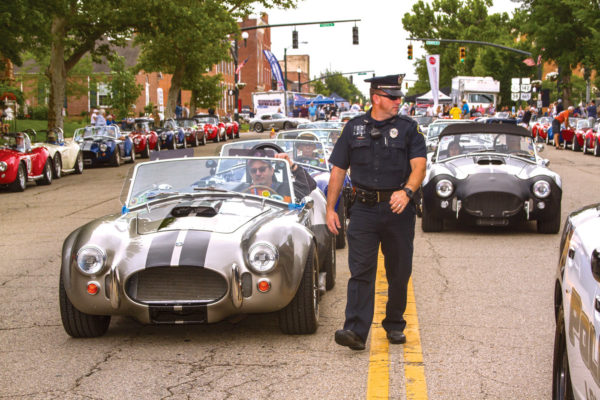 Under the watchful of eye of the local police, Cobras are available for thrill rides for a small donation to the Cystic Fibrosis Foundation.
