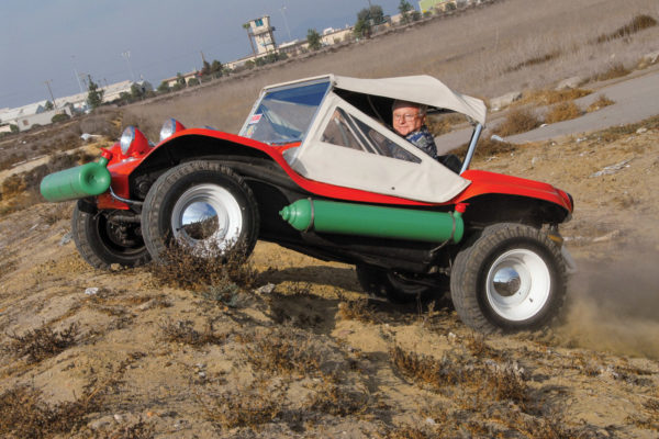 Bruce Meyers demonstrates the off-road capabilities of his first dune buggy, Old Red.