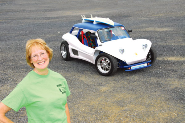 Kathleen Iacoboni beams with pride over her show car — when it's not covered with desert dust, of course.