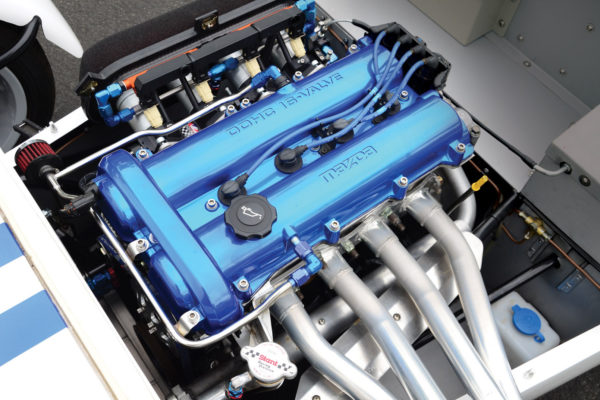 The cooling system on the Miata engine was modified to provide better flow by going back to the front-wheel drive coolant route, with the intake at the front of the engine.