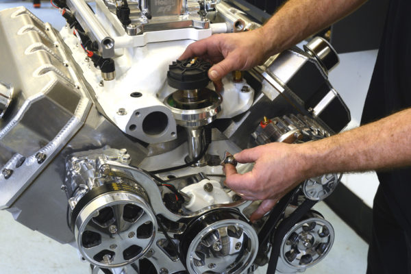Because the intake manifold is raised, a distributor extension is required with most conventional intake manifolds.