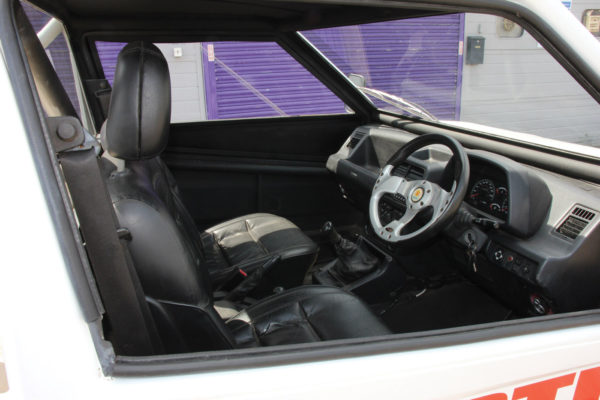 The Vitara's factory dash, pedals and center console are left intact.