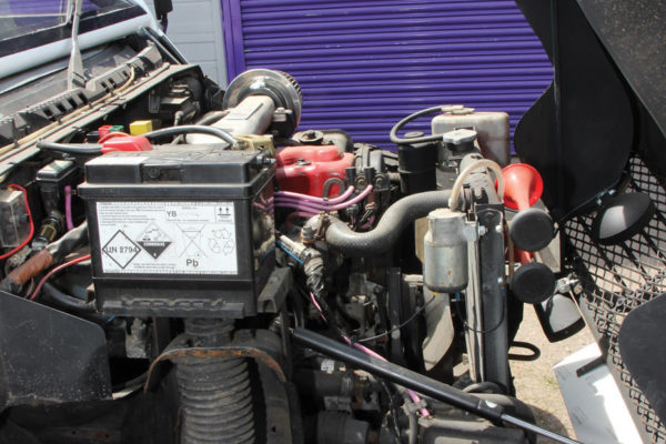 The only engine mod needed is to relocate the battery 8 inches into the bay. Note the forward-tilting hood.