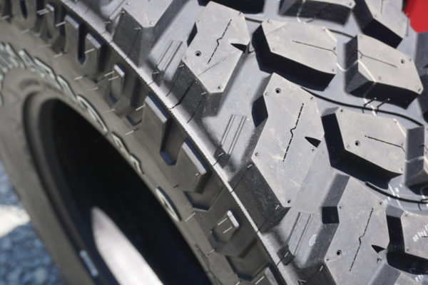 The open tread design of the Firestone Destination M/T2 allows the tread blocks to dig in and shed stones. Stone-shedding is assisted by those little ribs in between the tread blocks. Each block is sliced with a sipe to help with snow and ice traction. Finally, the little holes allow you to add metal studs for additional ice traction.