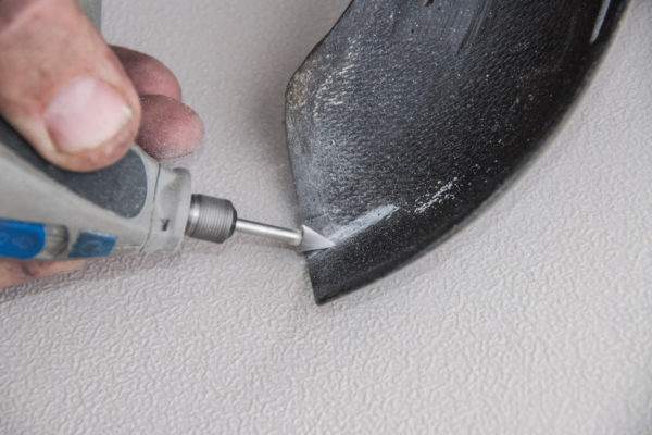Start by grinding a groove into the backside of the area to be repaired to ensure a good bond within the crack.
