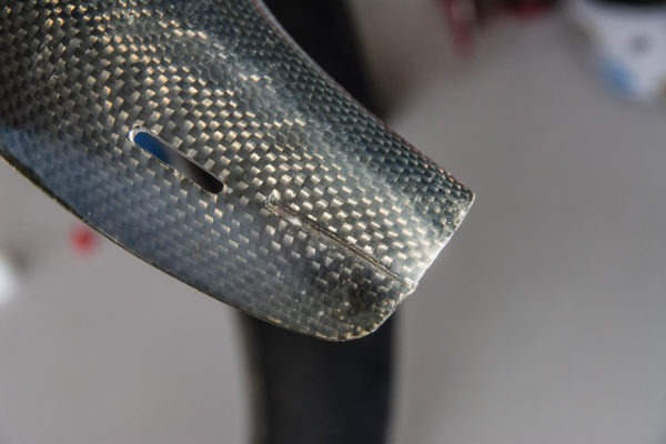 The outer surface of the repair can be sanded and buffed so it blends in with the surrounding material. Shown here is a similar repair completed at the other end of the same piece of carbon fiber.