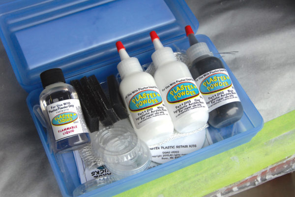 The Plastex kit consists of three bottles of acrylate powder (clear, white and black, and colored additives are available for matching hues), a liquid hardener (methyl acrylate monomer), and a special untreated, nonreactive fiberglass cloth, for larger repairs.