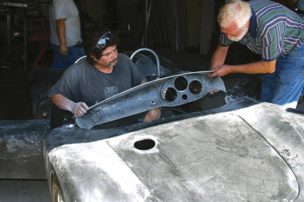 Here Thunder Ranch honcho Tom McBurnie (right) and his former shop manager cut the dash from the cockpit to afford easy access to the car's wiring and have the ability to replace the windscreen if necessary.
