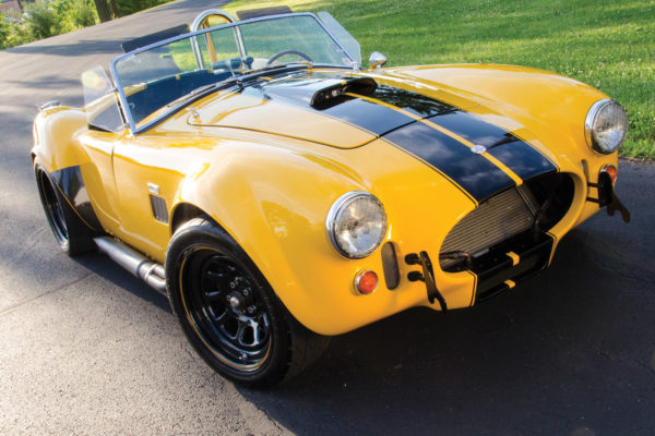 The yellow-and-black bumblebee color scheme is fitting on Phil White's Cobra, as it has a sharp sting of nitrous under the hood.
