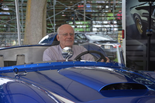 Bill Wuesthoff, driver of one of the original Scarabs, sits in a Scarab Motorsports continuation car.