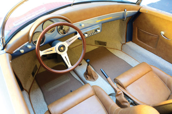 The camel-colored cockpit upholstery and German-weave carpet contrasts nicely with the bright blue '58 Porsche paint.