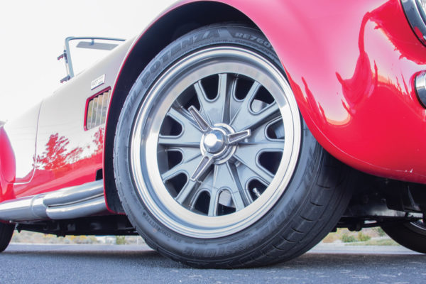The rims are genuine 17-inch knockoffs complete with safety-wired spinners and wrapped with Bridgestone Potenza rubber.