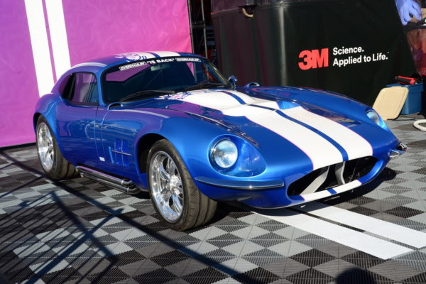 Peter Brock and Chip Foose were on location to unveil this Superformance Daytona Coupe makeover. The car is equipped with unique bumpers, as well as many significant additions for its female pilot, such as the flowers incorporated in the stripes.