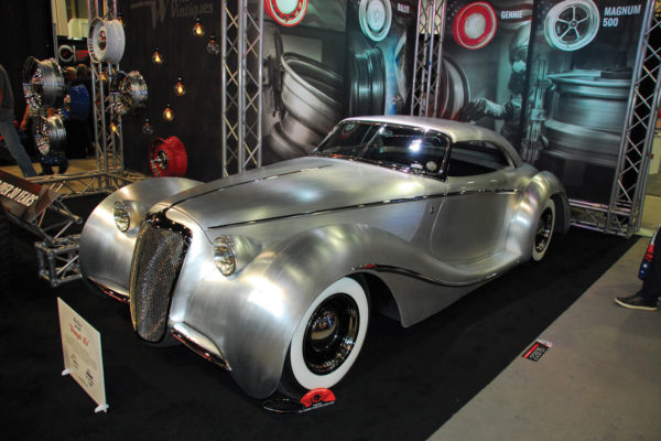 Rick Dore Kustoms' Shangri-La is perfection on wheels, an elegant roadster that marries classic French styling and American engineering. The  aluminum body was hand formed by Marcel.