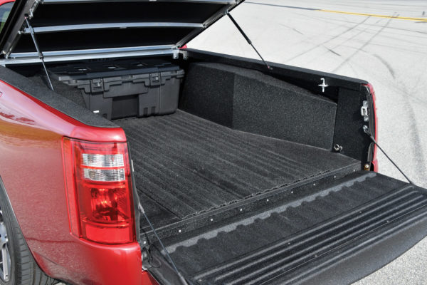The reinforced aluminum-panel bed is completely functional for hauling, and it has Line-X sound deadening throughout.