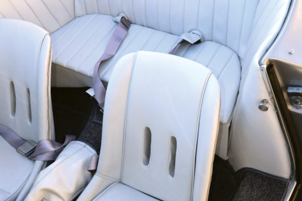 The interior is graced with a classy, light-gray color scheme and a custom rear seating area.