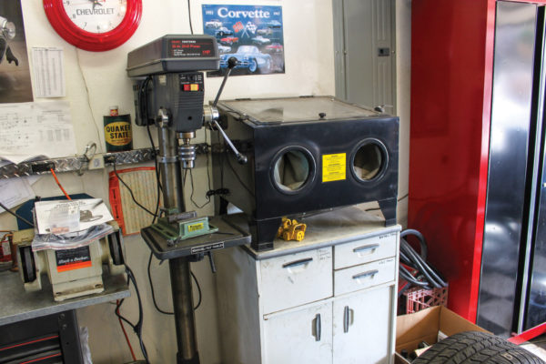 A sandblasting cabinet is useful, particularly for powder-coating. Next to that is a Craftsman floor-mounted drill press. The little castoff bench grinder at left is used only for sharpening the TIG welder tungsten rods.