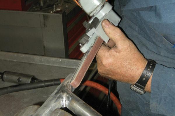Final sanding is done using a hand-held, half-inch belt sander.