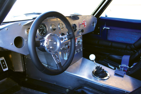 The steering wheel is a leather-wrapped Moto-Lita with a quick release and instrumentation is Stewart Warner.