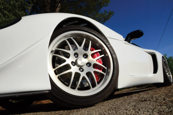 The custom wheels are brushed and cleared, and wrapped with Bridgestone rubber. Brakes are Corvette C6 Z06.