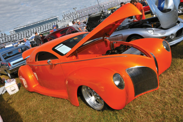 Shimmering in House of Kolor Sunset Orange, Deco Rides' 1939 Lincoln Zephyr boasts a 4.6-liter V8, four-speed automatic transmission, Ridetech air suspension, and full stereo.