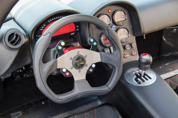 The cockpit is outfitted with a Summit Technologies Raptor Pro Bluetooth steering wheel with push-button controls, plus an AiM Motorsports MXL2 dash data logger.