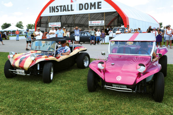 The dune buggy with the flag paint job (left) is from Joe Botterbush, who won the Exhaust Wars Sound Off. The pink car with big eyelashes (wink, wink) belongs to Babe Edsall, who was also a winner in the Exhaust Wars Sound Off.