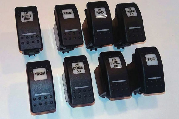 Switches were laser engraved with the required functions, and then filled with black enamel so they can be read when backlit.